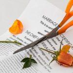 scissors cutting a marriage certificate