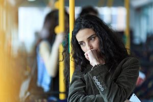 Pensive woman traveling on public transportation